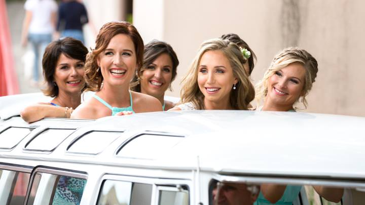 Bridal party arrive in style - stretched Volkswagen limousine